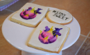 sugar cookies painted by Melanie featuring an abstracted heart in pretty pinks and purples. One of the cookies says stay sweet on it.