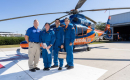 ShandsCair team of four people posing in front of a ShandsCair helicopter